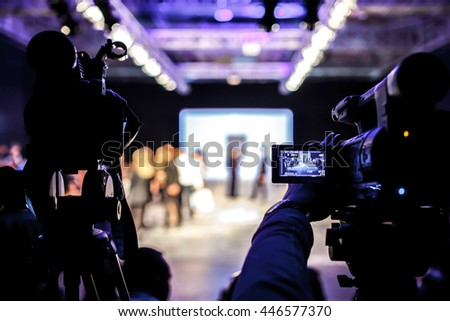 Television Camera Broadcasting a Fashion Show, Catwalk Event. Royalty-Free Stock Photo #446577370