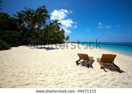 Beautiful lonely beach with chairs #44671153