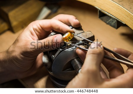 Craft jewelery making with professional tools. Ring repairing. Putting the diamond on the ring. Macro shot.  A handmade jeweler process, manufacture of jewellery. #446748448