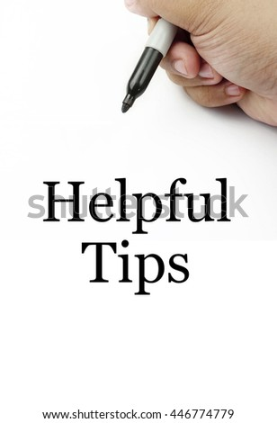 "Handwriting of ""helpful tips"" with the white background and hand using a marker. #446774779"