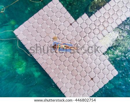 Woman on pontoon bridge aerial view #446802754