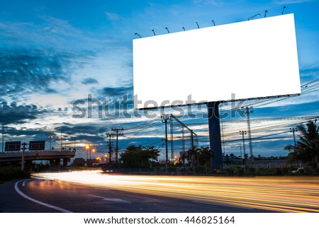 Blank billboard for advertisement at twilight time with light trails on the road at dusk, business advertising concept.  #446825164