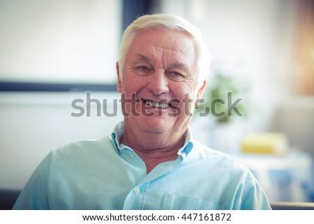 Portrait of happy senior man at home #447161872