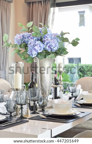 elegant table set on marble dining table in modern style dining room interior #447201649