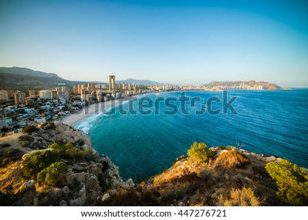 Breathtaking view of the coastline in Benidorm with high buildings, mountains and sea #447276721