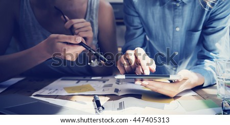 Closeup photo Girl Touching Screen Digital Tablet Hand.Project Producer Researching Process.Business Crew Working New Startup modern Studio.Analyze market stock,strategy.Blurred,film effect.Horizontal