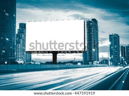 Blank billboard on the highway during the twilight with city background with clipping path on screen.- can be used for display your products or promotional #447591919