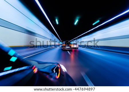 Blurry chromatic color tunnel car traffic motion blur. Motion blur visualizies the speed and dynamics. #447694897