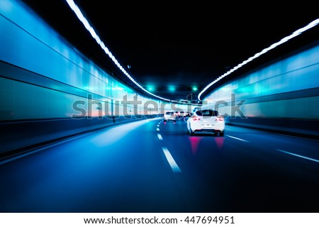Blurry chromatic color tunnel car traffic motion blur. Motion blur visualizies the speed and dynamics. #447694951