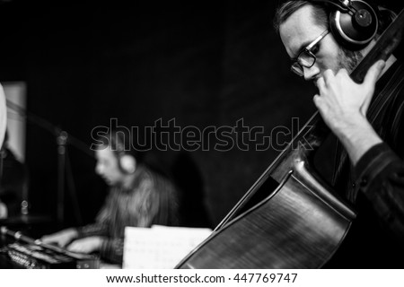 Musician playing bass at the jazz concert #447769747