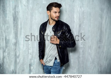 Photo of handsome man in black leather jacket Royalty-Free Stock Photo #447840727