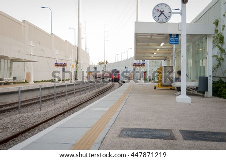 HOLON, ISRAEL. June 2016. Train arriving to the empty platform at the Holon Wolfson train station. Structure works, strike, Israel trains stock image. #447871219