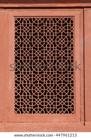 Floral designs in the window of Diwan-e-khas in Fatehpur Sikri #447961213