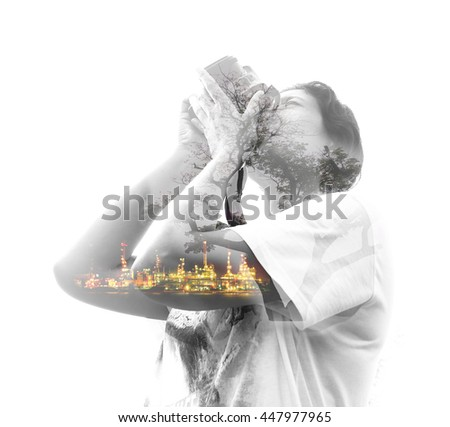 Double exposure image of woman holding camera and nature background