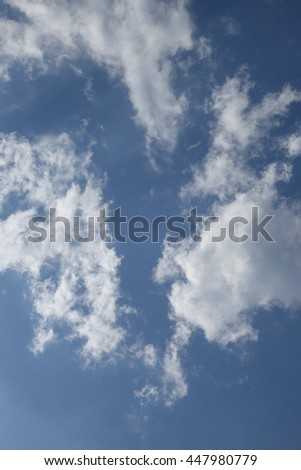 Clouds in the blue sky #447980779
