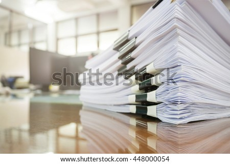 Pile of unfinished documents on office desk, Stack of business paper Royalty-Free Stock Photo #448000054