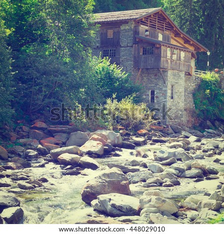 Medieval City on the Shore of a Mountain River in Italian Alps, Retro Effect #448029010
