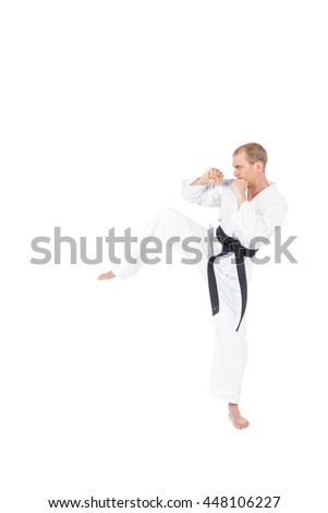 Fighter performing karate stance on white background #448106227