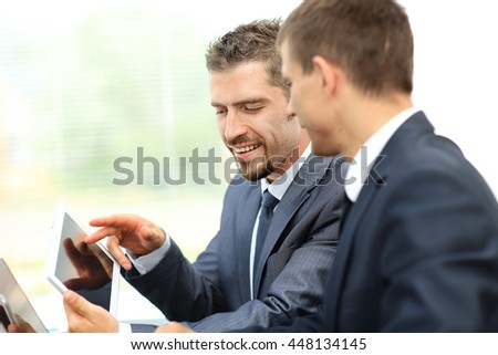 Business people working with tablet in an office #448134145