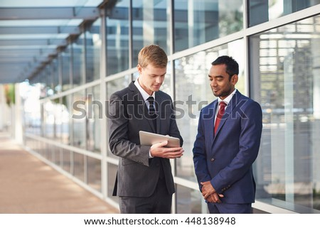 Two savvy business minds on the project Royalty-Free Stock Photo #448138948