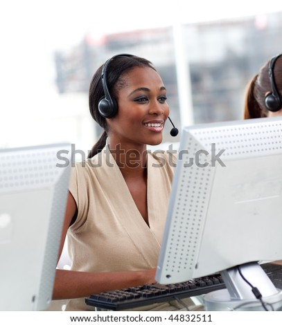 Female customer service agent with headset on in a call center #44832511