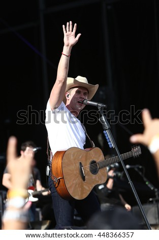 NASHVILLE-JUL 11: Country recording artist Dustin Lynch performs during the 'Kick The Dust Up' Tour at Vanderbilt Stadium on July 11, 2015 in Nashville, Tennessee. #448366357
