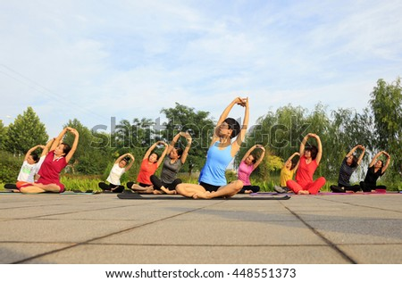 Tangshan - July 3: women doing yoga exercise in the park, July 3, 2016, tangshan city, hebei province, China  #448551373
