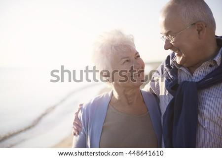 Senior marriage walking on the beach #448641610
