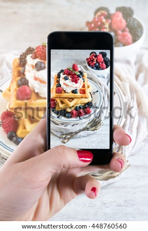 Photographing Belgium waffles with berry fruits and ice cream on top,selective focus