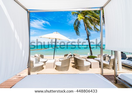 Outdoor deck with pillow neary beach and sea with coconut palm tree on blue sky background #448806433