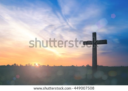 Funeral customs of christian religions concept: The Cross on autumn sunset background