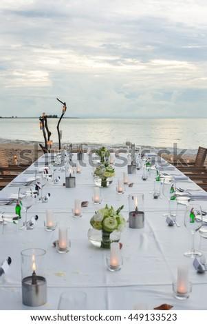 Long table wedding dinner setup on the beach at  Thailand #449133523