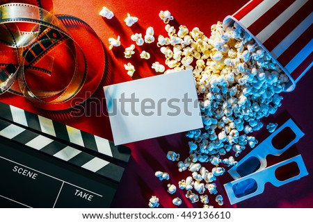 Blank cinema promo card or ticket, popcorn, filmstrip and clapper, movies and entertainment concept Royalty-Free Stock Photo #449136610
