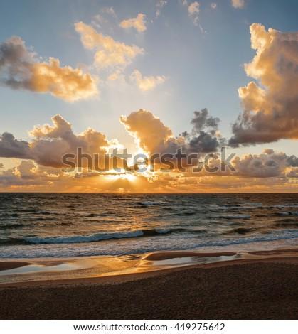 Sunset. Beautiful sunset at baltic sea. Gold sea sunset. Picture Sea sunset. Sea sunset background. Wonderful sea sunset Sunset sea picture. Sunset sea waves. Summer sunset.