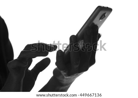 black and white silhouette of a touchscreen smartphone that uses a woman Royalty-Free Stock Photo #449667136