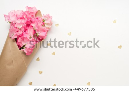 image of pink flowers, gold hearts on white background
