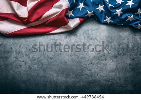 American flag freely lying on concrete board. Royalty-Free Stock Photo #449736454