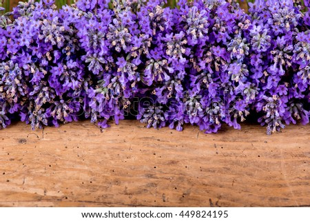 frame of lavender on a rustic wooden background - selective focus, copy space #449824195