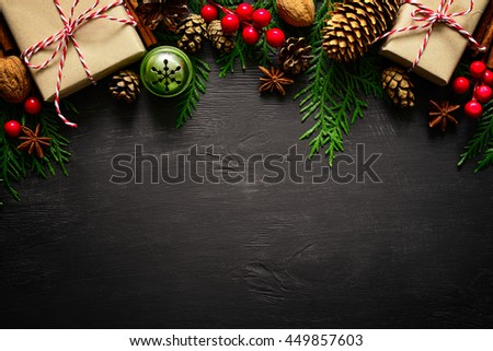 Christmas or New Year dark wooden background, Xmas black board framed with season decorations, space for a text, view from above Royalty-Free Stock Photo #449857603