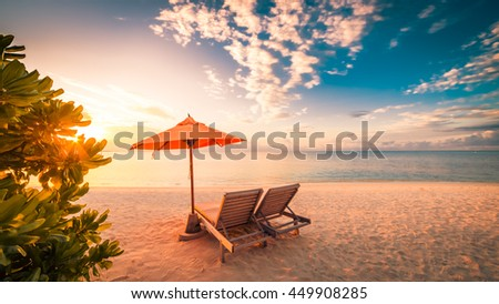 Vacation holidays background wallpaper, two beach lounge chairs under tent on beach. Beach chairs, umbrella and palms on the beach. Tropical Holiday Banner #449908285