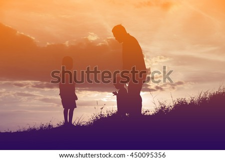 Happy family dancing on the road in the sunset time. Evening party on the nature #450095356