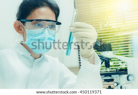 Scientists are certain activities on experimental science like mixing chemicals, use microscope, entry data to develop medicines or foods for everyone on the world, copy space, film effect. #450119371