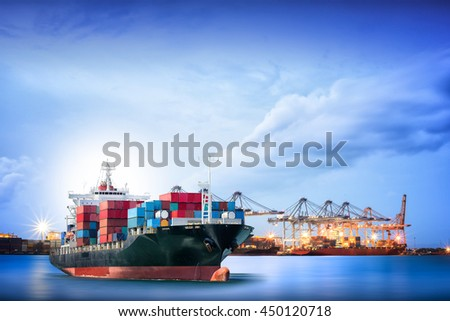Logistics and transportation of International Container Cargo ship with ports crane bridge in harbor for logistic import export background and transport industry. #450120718