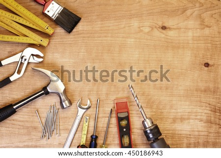 Assorted work tools on wood #450186943