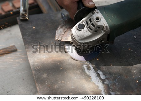 The process of grinding after welding metal. Sparks #450228100