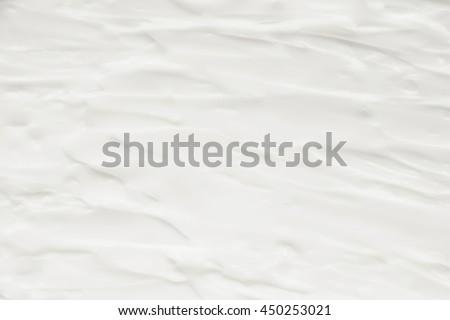 Cosmetics. Cream white background texture. #450253021