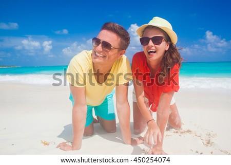 beautiful happy couple having fun at sunny beach #450254074