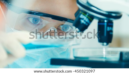 scientist with equipment and science experiments ,laboratory glassware containing chemical liquid for design or decorate science or other your content and selective focus Royalty-Free Stock Photo #450321097