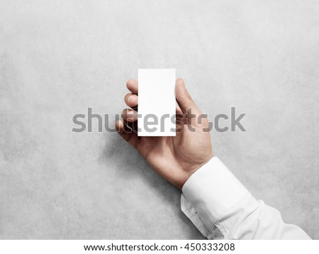 Hand hold blank vertical white business card design mockup. Plain calling card mock up template holding arm. Visit pasteboard paper display front. Small offset clear card print. Company logo branding