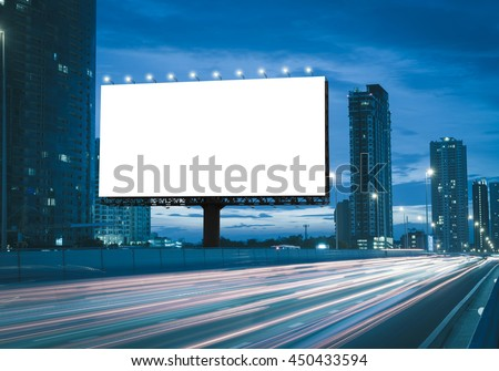 Blank billboard on the highway during the twilight with city background with clipping path on screen.- can be used for display your products or promotional #450433594